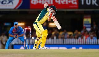 David Warner being bowled out by India's Bhuvneshwar Kumar.