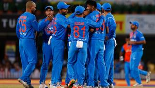 Indian cricketers celebrate the dismissal of Australia's Glenn Maxwell.
