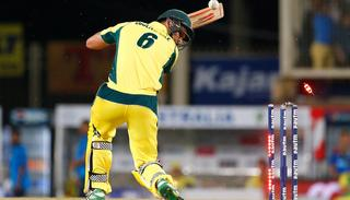 Australian cricketer Coulter-Nile is bowled out by India's Jasprit Bumrah.