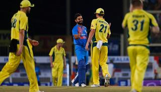 Australian cricketers congratulate captain Virat Kohli after India beat Australia in the their first T20.