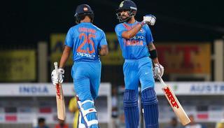Virat Kohli and Shikar Dawan interact during the first T20I.