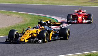 Renault driver Nico Hulkenberg of Germany leads Ferrari driver Kimi Raikkonen of Finland during the Japanese Formula One Grand Prix at Suzuka.