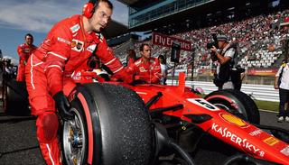 Ferrari's Sebastian Vettel retires as his car is taken to the pit.