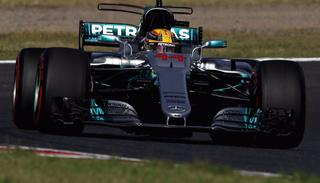 Mercedes driver Lewis Hamilton of Britain steers his car during the Japanese   Grand Prix.