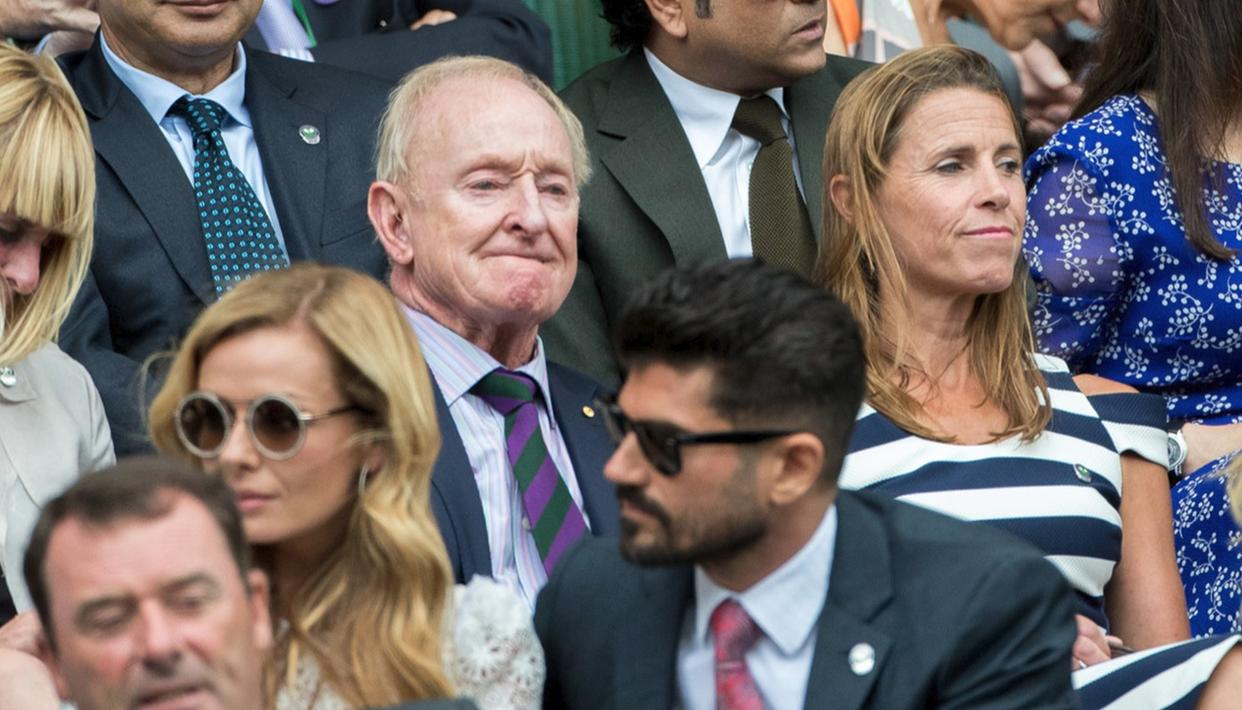 Tennis legend Rod Laver takes his place at the Royal Box to see the heavyweight semifinal clash
