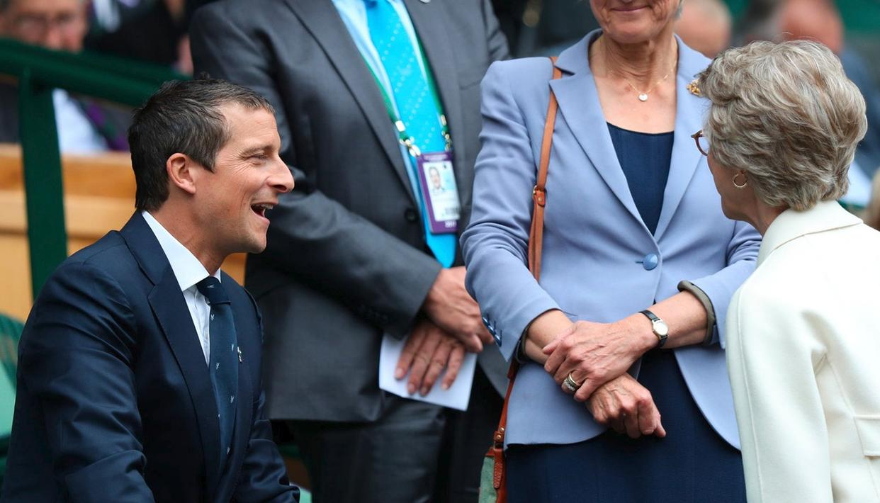 Televison presenter Bear Grylls looks unusually suave as he takes his seat at the Royal Box in the Centre Court