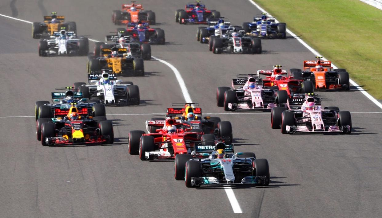 Mercedes driver Lewis Hamilton of Britain leads the field at the start of the Japanese Formula One Grand Prix.