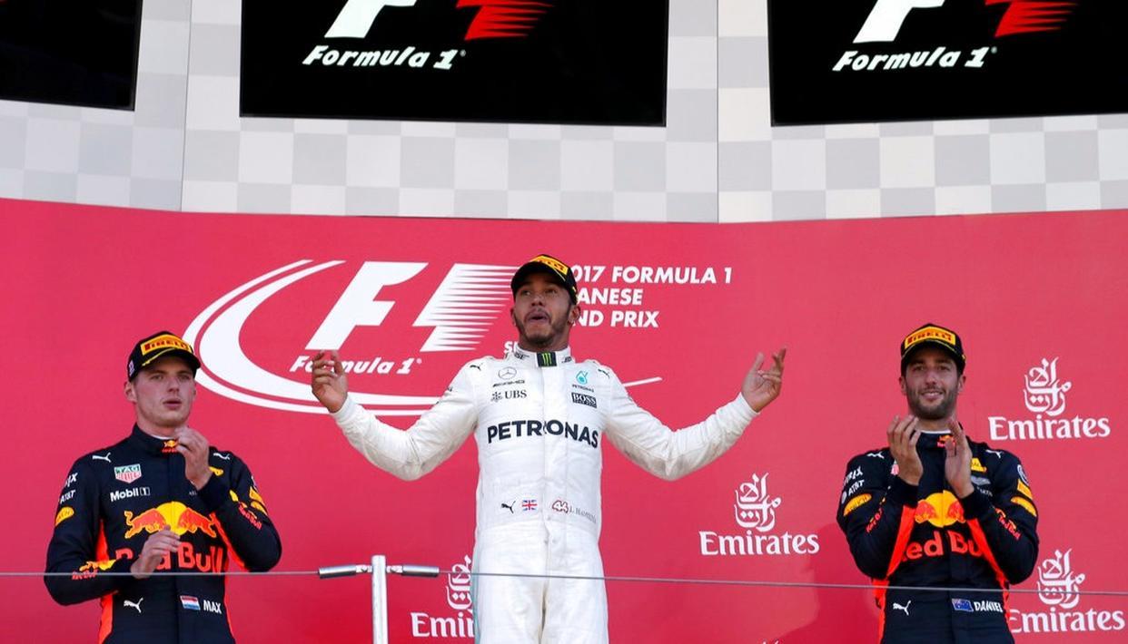 Lewis Hamilton of Britain celebrates on the podium.