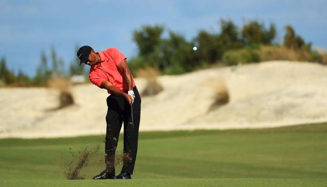 WOODS FINISHES 9TH ON COMEBACK