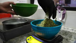In this June 27, 2017, photo, an employee weighs sifted pot leaves to make joints at the Higher Path medical marijuana dispensary owned by Jerred Kiloh in Los Angeles.