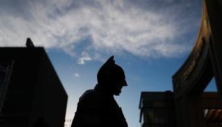 In this photo, Batman impersonator Matthias Balke is silhouetted while standing on Hollywood Boulevard near the Dolby Theatre in Los Angeles. (AP)