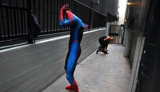 In this photo, two Spider-Man impersonators, Rashad Rouse, front, and Juan Carlos Banegas, an immigrant from Honduras, change in the alley next to the TCL Chinese Theatre after working on Hollywood Boulevard in Los Angeles.(AP)
