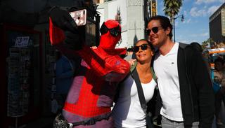 In this photo, superhero impersonator and actor Dan Inigo, left, uses a tourist's smartphone to take a selfie on Hollywood Boulevard in Los Angeles.(AP)