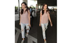 Evelyn Chopra pulling off the famous combo of tassel earrings & ripped jeans