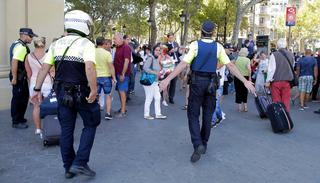 Police ask people to be calm after the attack. (AP Photo)