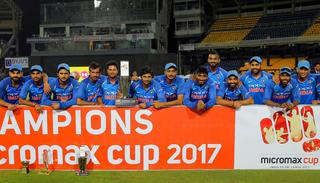 Members of Indian cricket team pose with the winners trophy after the win .