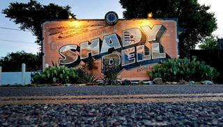 The front office of the Shady Dell trailer court is illuminated at dawn, Wednesday, April 26, 2017, in Bisbee, Ariz.