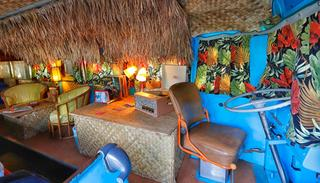 The interior of a 1947 Airporter bus is decorated in a 1950's Hawaiian theme at the Shady Dell Trailer Court, Tuesday, April 25, 2017, in Bisbee, Ariz.