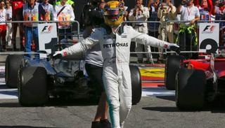 Mercedes driver Lewis Hamilton of Britain celebrates after winning.