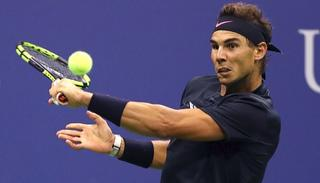 Rafael Nadal of Spain returns a shot against Kevin Anderson in the finals.