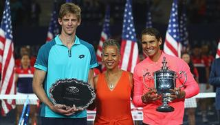 Kevin Anderson of South Africa and Rafael Nadal of Spain pose with USTA President Katrina Adams during the trophy ceremony.