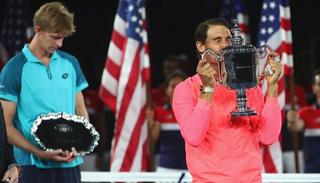 Nadal and Anderson pose with their respective trophies during the trophy ceremony.