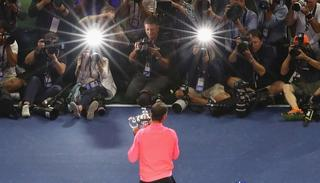 Photographers click pictures as Nadal poses with the Trophy.