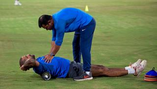 Indian cricketer Shikhar Dhawan stretches before the start of the third of the 3rd T20I.