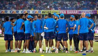 Virat Kohli talks to his teammates before the start of the third T20I.