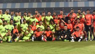 The All Hearts and All Stars team pose after the match.