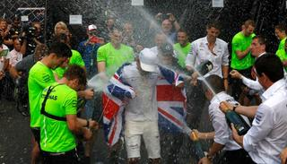 Mercedes driver Lewis Hamilton, of Britain, celebrates with his team at the pit lane after the Formula One Mexico Grand Prix.