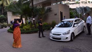 It seems Vidya has taken the role of a traffic cop a bit too seriously. She stops an oncoming car from exiting a building to monitor the traffic  (Pic by Viral Bhayani)