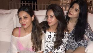 Gauri, meanwhile, takes time off from playing host and poses ofr a picture with her friends at the party.