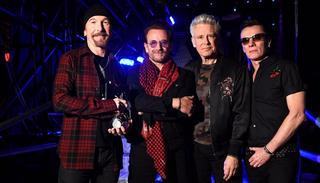 The Edge, Bono, Adam Clayton and Larry Mullen Jr of U2 pose with the Global Icon award during the MTV EMAs 2017