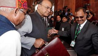Finance minister Arun Jaitley holds his briefcase as he arrives at Parliament to present the Union