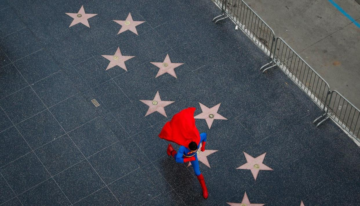 In this photo, wearing a Superman costume, Toly Shtapenko, of Ukraine, takes a long stride along the Hollywood Walk of Fame to impress tourists, in the Hollywood section of Los Angeles. (AP)