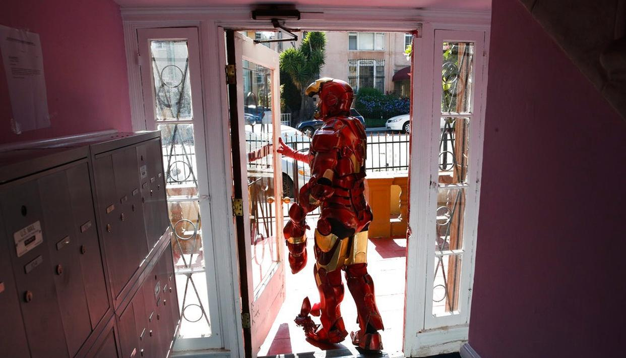 In this photo, wearing a $5,000 Iron Man costume, actor Paul Louis Harrell leaves his apartment building, in the Hollywood section of Los Angeles.(AP)