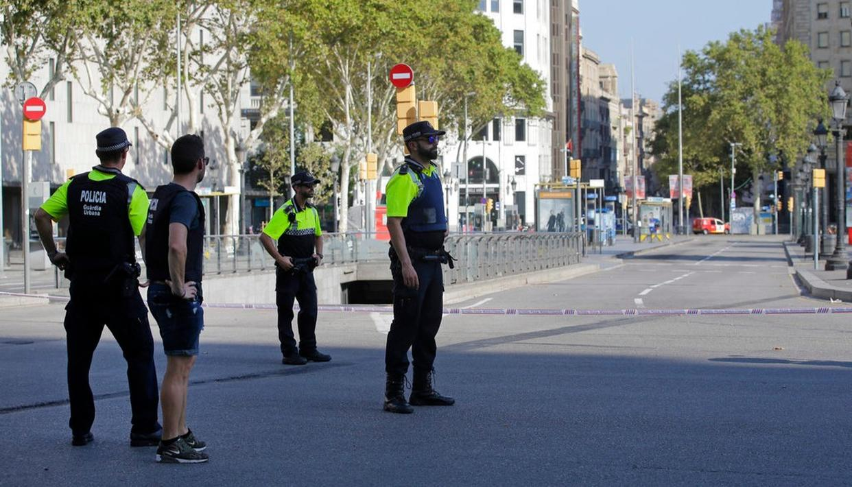 olice officers cordon off a street in Barcelona, Spain. (AP Photo)