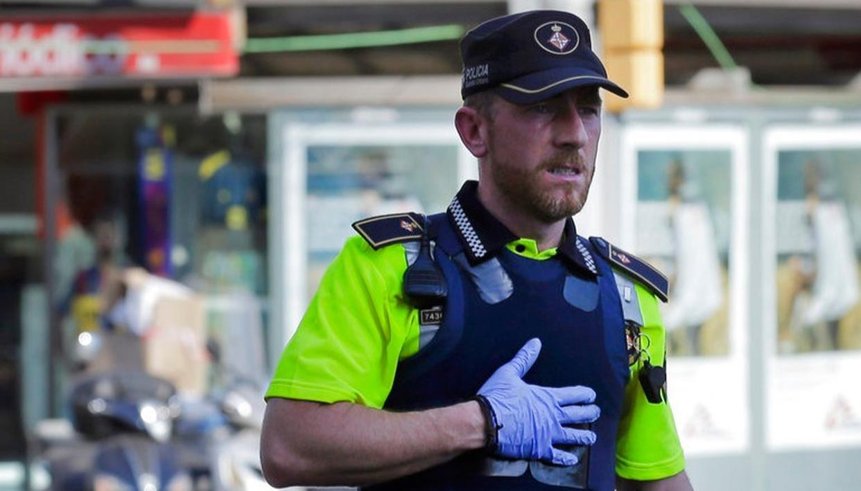 Police officer guarding the street where the attack happened. (AP Photo)
