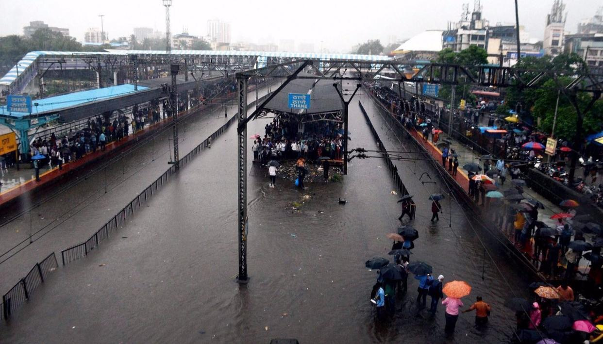 Thane railway station is completely flooded bringing Central Railway trains to a halt after heavy rains lashed Thane in Mumbai on Tuesday. (PTI Photo)