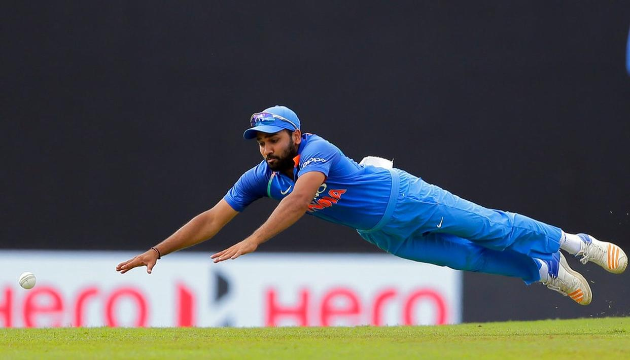 Rohit Sharma dives to field the ball.