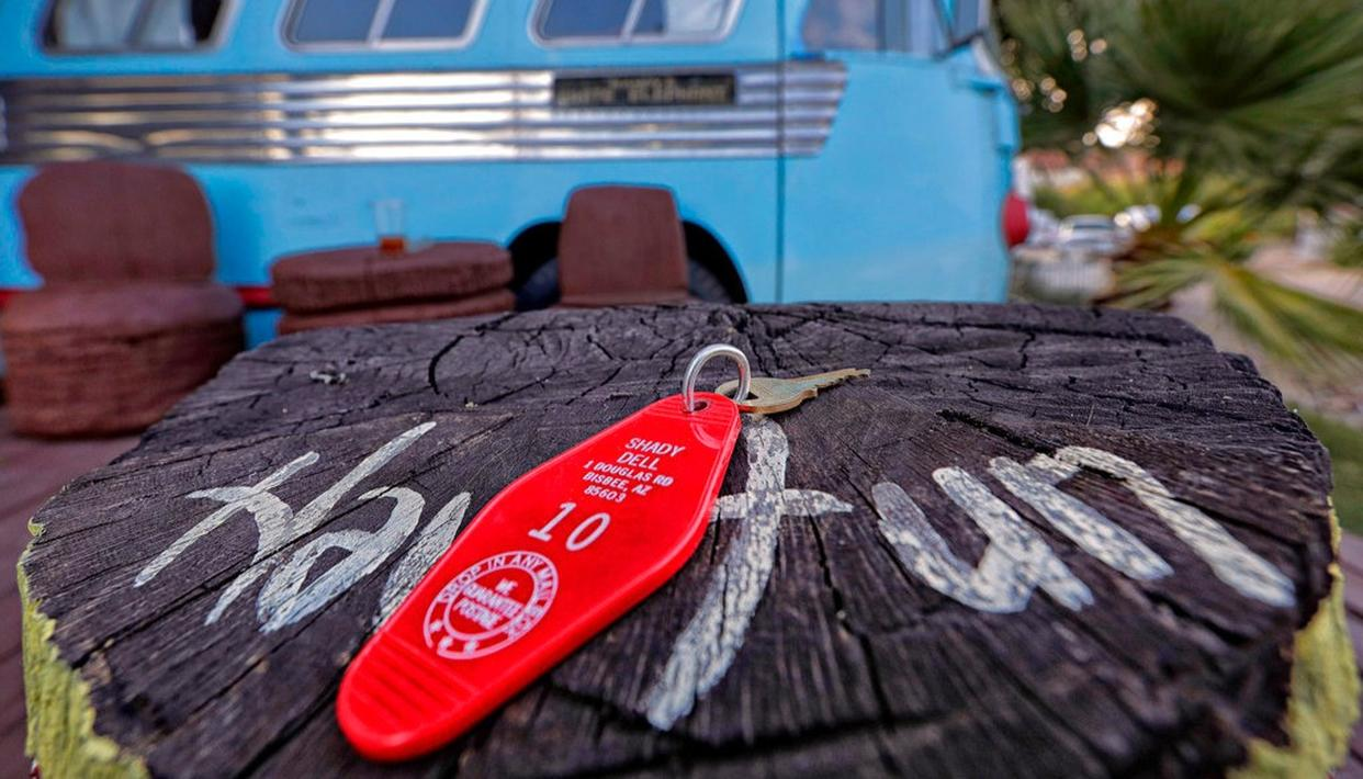 A retro motel room key to a 1947 Airporter bus sits on a tiki pole at the Shady Dell Trailer Court, Tuesday, April 25, 2017, in Bisbee, Ariz.