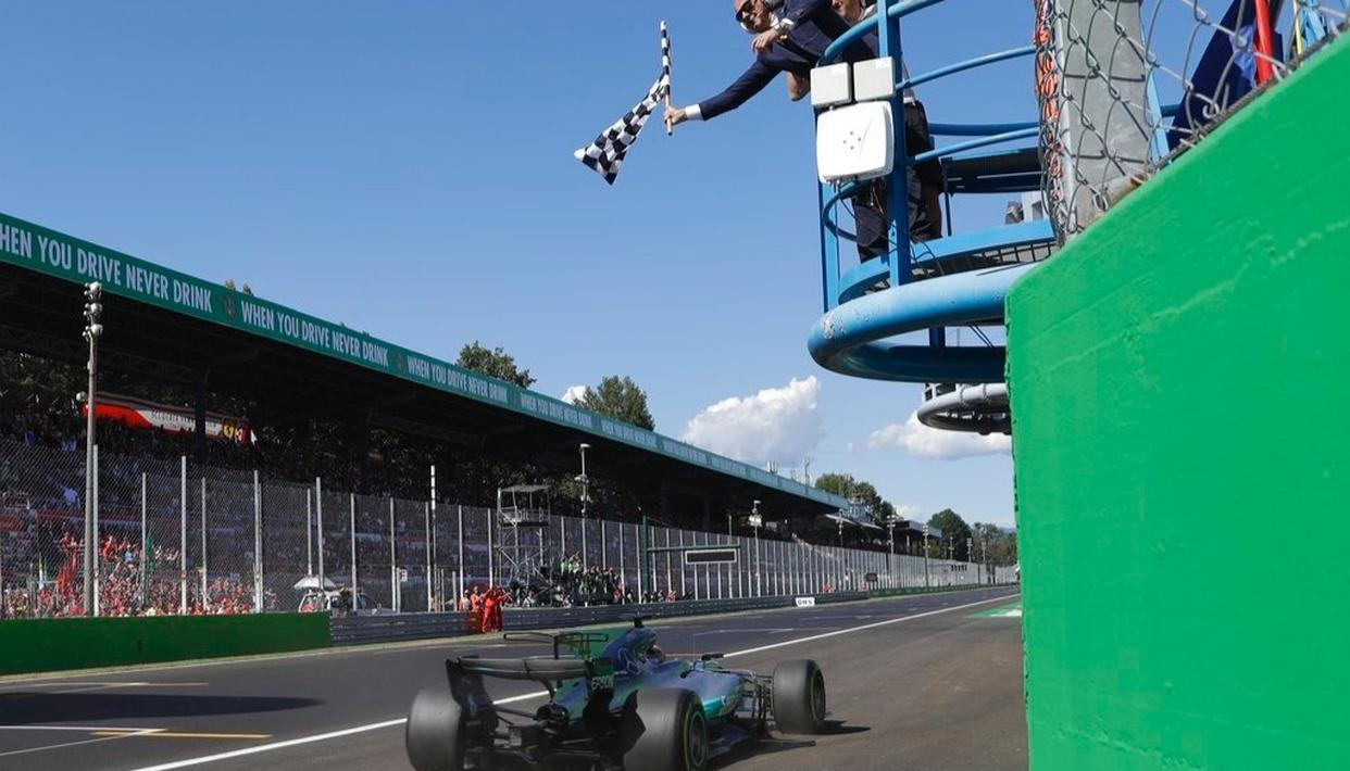 Mercedes driver Lewis Hamilton of Britain gets the checkered flag as he crosses the finish line to win the Italian Formula One Grand Prix.