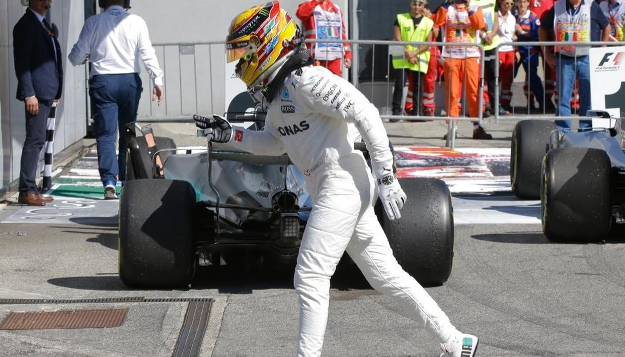 Mercedes driver Lewis Hamilton of Britain celebrates after winning the Italian Formula One Grand Prix.