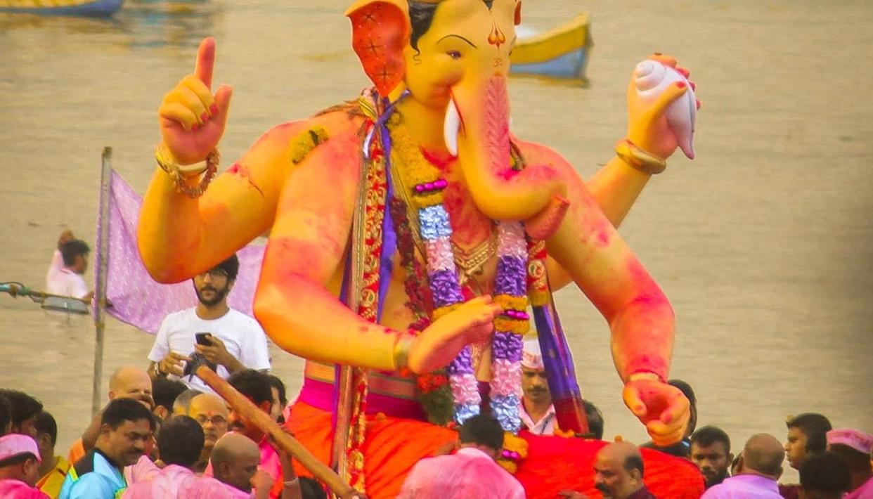 Lalbaug Cha Raja towering over the crowd in his final journey.
