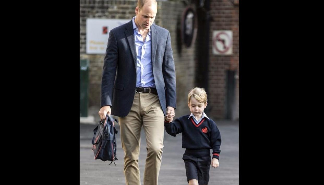 Daddy's taking you to school! Prince William, left, holds Prince George's hand as he arrives for his first day of school