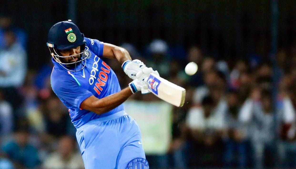 Rohit Sharma strikes the ball for a 103 meter six.