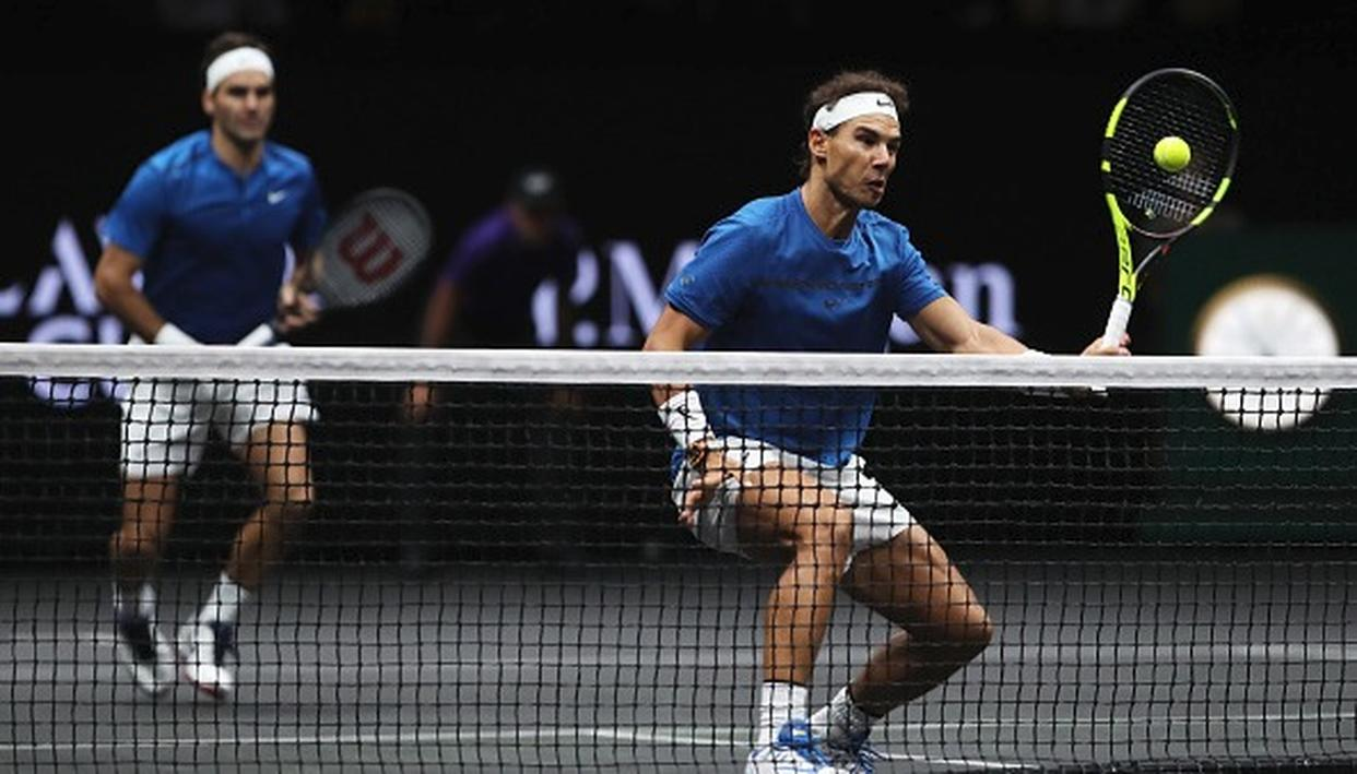 Rafael Nadal and Roger Federer during their doubles match.