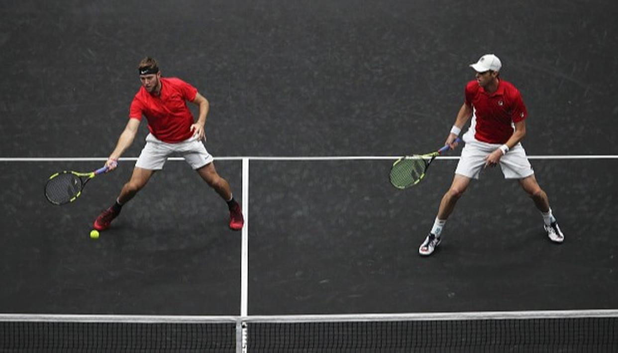 Jack Sock and Sam Querrey of Team World in action during there doubles match against Roger Federer and Rafael Nadal.