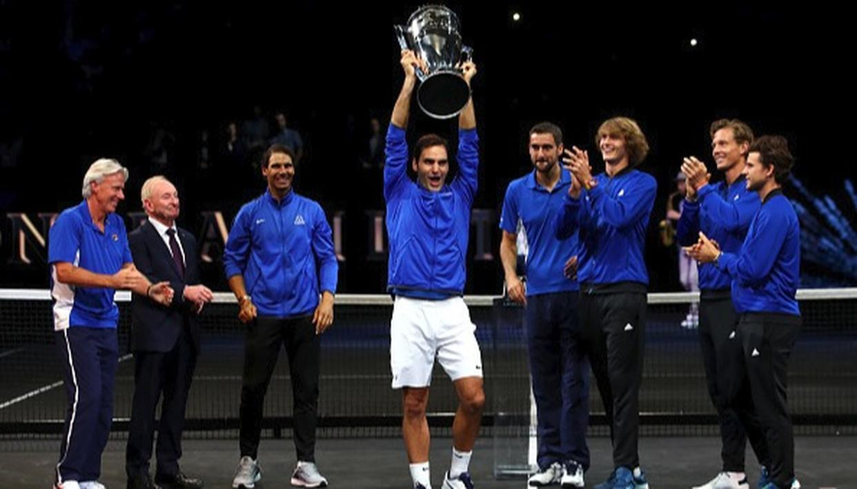 Roger Federer of Team Europe lifts the Laver Cup trophy on the final day.
